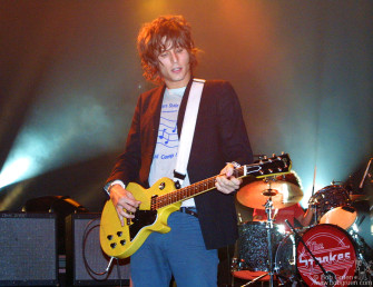 Nick Valensi plays as the Strokes start their set.