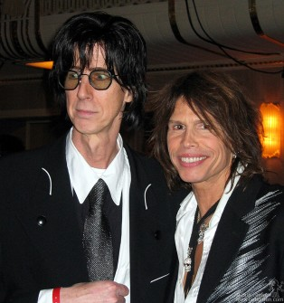 Ric Ocasek and Steven Tyler check out the room as the dinner begins.