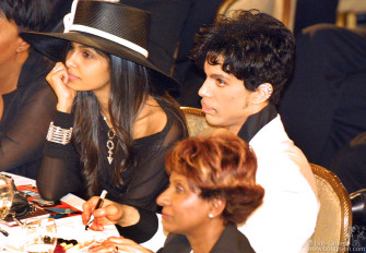 Prince started off the evening on a very upbeat note performing three songs and then was inducted into the Hall of Fame. We weren't allowed to photograph his show, but I got a shot as he returned to his party at his table.