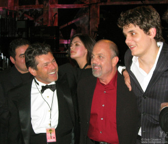 Rolling Stone Magazine publisher and one of the founders of the R&R Hall of Fame Jann Wenner greets Billy Joel and John Mayer.