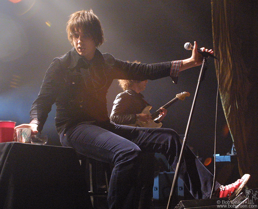 Julian had recently hurt his knee in a car accident and performed most of the show sitting down.