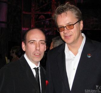 Mick Jones says hello to tall actor Tim Robbins.