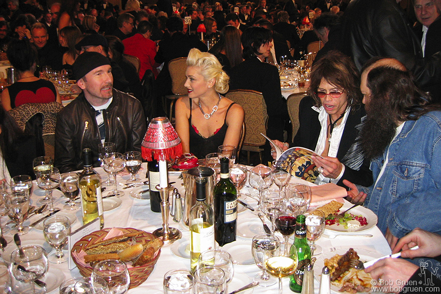 U2's The Edge chats with Gwen Stefani while Steven Tyler checks out the program book with producer Rick Rubin.