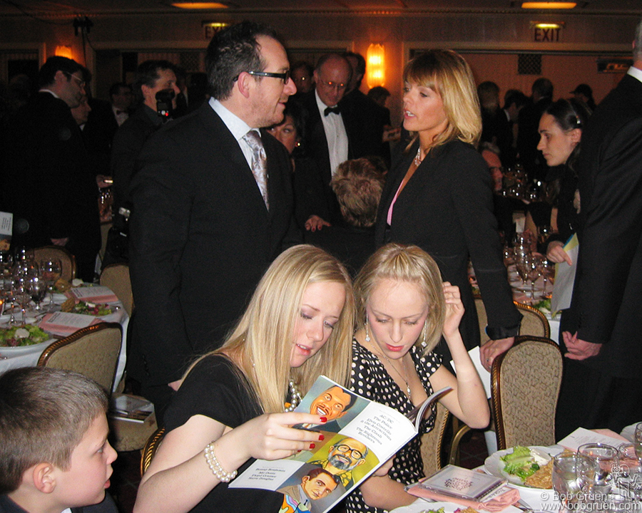 Elvis says hi to Lucinda Strummer as Joe's daughters Lola and Jazz look at the photos in the program.