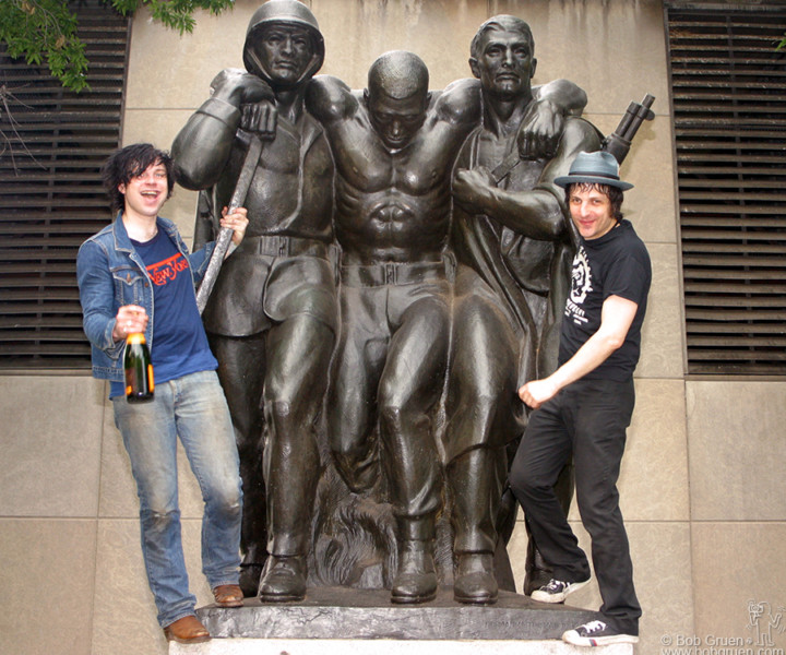 Ryan gets a bottle of champagne and celebrates with Jesse on the Coast Guard Statue in the park.