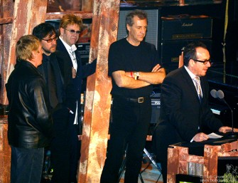 """Sir Elton John inducted Elvis Costello and The Attractions. Elvis called radio """"music's mortal enemy', and put down the """"corporate raiders"""" who wrecked the music business."""