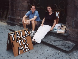 These two, Bill Wetzel and Liz Barry, have been seen sitting by the sidewalks around New York City with this sign. It is their art to try to help people communicate with each other. If you see them, talk to them, and maybe you'll be inspired to talk to other people as well.