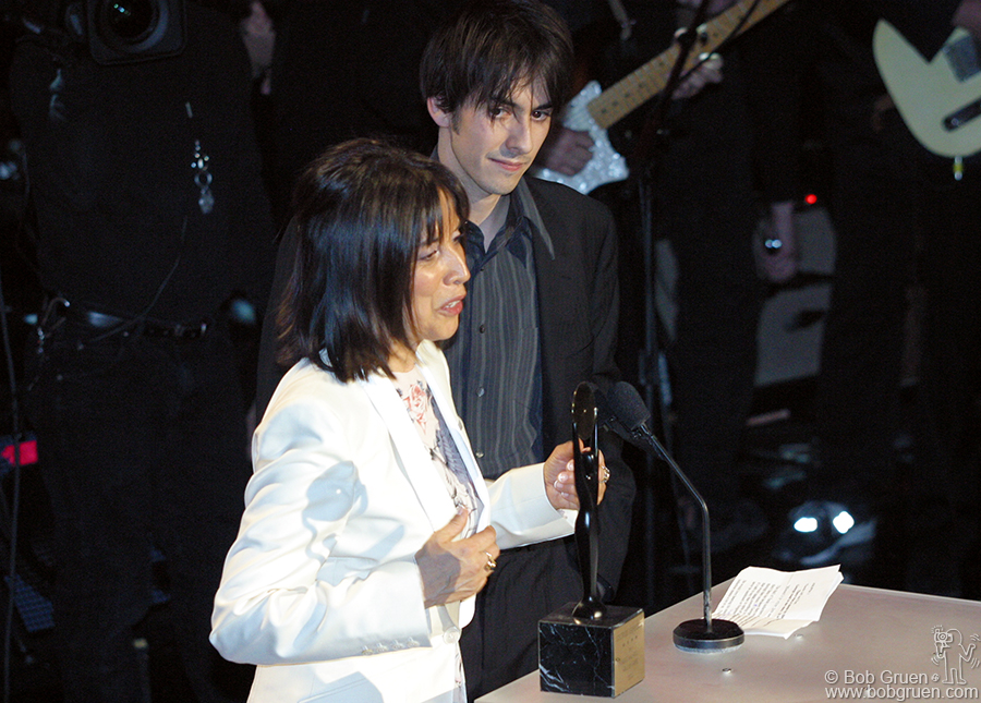 George Harrison's widow Olivia and their son Dhani accepted the honors for George.