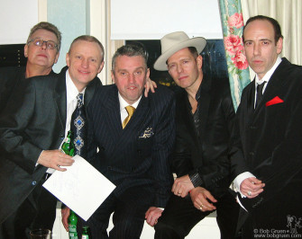 """After the show, Mick Jones invited a few friends up to his room to unwind. Above are Johnny (Green) Broad, who wrote one of the best books about the Clash titled """"A Riot of Our Own"""", drummer Terry Chimes, Clash spokesman Kozmo Vinyl, and Paul and Mick."""