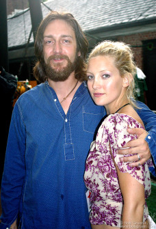 Chris Robinson opened the show at Central Park's Summerstage July 11 and the fans cheered as he kept playing through a thunderstorm. His beautiful wife Kate Hudson was there with him, lookin' good and expecting their baby next January.