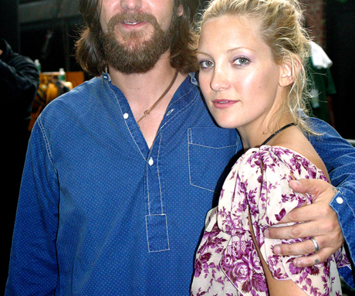 July 11 - NYC - Chris Robinson opened the show at Central Park's Summerstage July 11 and the fans cheered as he kept playing through a thunderstorm. His beautiful wife Kate Hudson was there with him, lookin' good and expecting their baby next January.