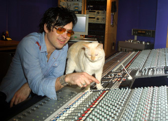At Electric Lady Studio, Ryan made friends with the studio's pet cat, Jimi. This shot was published the next week in Rolling Stone Magazine.