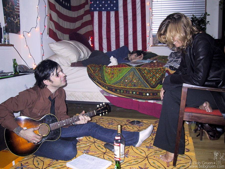 Aug 30 - NYC - Sometime very late that same night we went back to Ryan's apartment. Above, my wife Elizabeth listens as he plays some of his new songs.