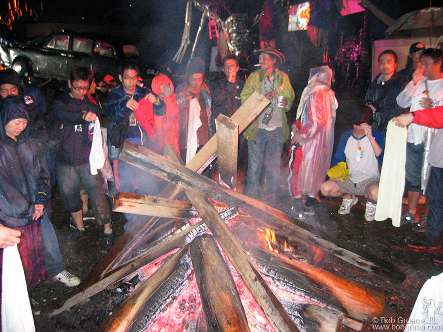 July 25 - Japan - In a free area just outside the main entrance known as the Palace of Wonder, Jason Mayall and a gang of Joe Strummer's friends from England kept a bonfire burning all weekend. It was a good place to warm up and dry out from the rain.