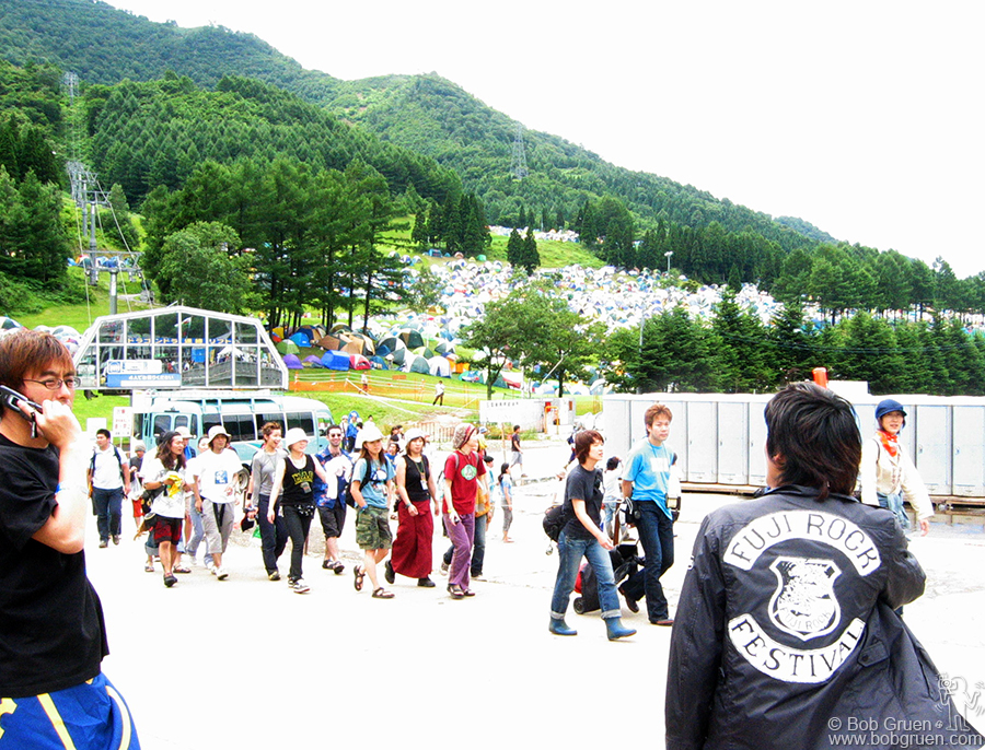 July 25 - Japan - Many people camp out in the fields around the stages. It is one of the cleanest festivals I've ever been to. Everyone recycles their garbage and smokers carry little portable ashtrays and don't even drop a butt on the ground.