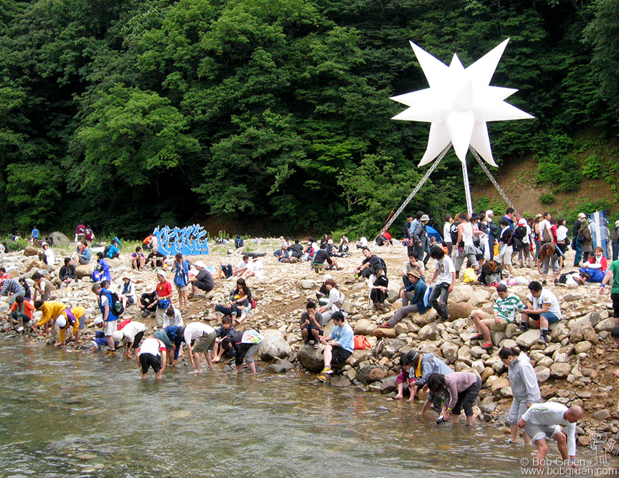 July 26 - Japan - People stop by the stream on the festival grounds to wash some of the mud off their feet. This year Masa built a boardwalk through the woods by the stream.