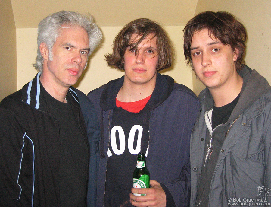 Film Director Jim Jarmusch greets Strokes Nikolai and Julian backstage at the White Stripes show. Jim has been working on a new film which includes a segment with the White Stripes. The Strokes took time out from recording their new album to come to the show and then went right back to their studio.(http://www.thestrokes.com)