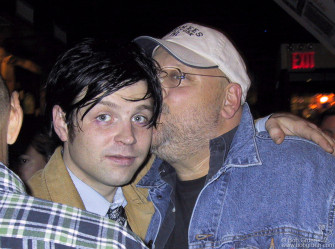 Ryan's manager Frank Callari looks like he's giving Ryan a kiss, but he's probably reminding him that he still has to go back to the studio to finish his new recording.