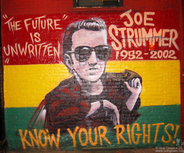 """Nov 16 - NYC - This is the centerpiece of a video for Joe Strummer's version of Bob Marley's """"Redemption Song"""" from Joe's new Mescaleros album """"Streetcore"""". The video, directed by Josh Cheuse shows artists Dr. Revolt and Zephyr creating this mural on the wall of the Niagara Bar in the East Village, while many of Joe's well known friends and local neighbors watch."""