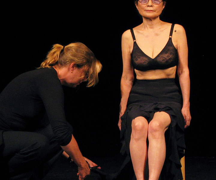 "Sep 15 - Paris - Yoko Ono performed her ""Cut Piece"" for the first time since 1965, For ""Cut Piece"" Yoko invited the audience to come onstage one at a time and cut a piece of her clothing off. It is a very tense event as Yoko is vulnerable to strangers. It is a piece symbolic of the way we must open ourselves to each other to obtain peace in the world."