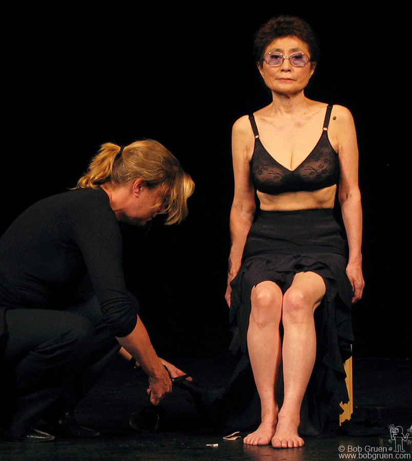 """Sep 15 - Paris - Yoko Ono performed her """"Cut Piece"""" for the first time since 1965, For """"Cut Piece"""" Yoko invited the audience to come onstage one at a time and cut a piece of her clothing off. It is a very tense event as Yoko is vulnerable to strangers. It is a piece symbolic of the way we must open ourselves to each other to obtain peace in the world."""