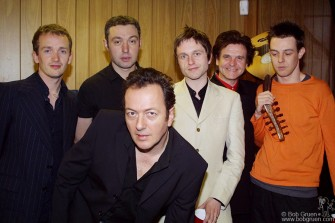 The Mescaleros pose before the show. From the left they are drummer Luke, bassman Simon (who also played the trombone), leader Joe Strummer, Martin who plays the guitar, flute, sax, harmonium and several keyboards; fiddle and banjo player Tyman Dogg and guitar player extraordinaire, Scott Shields.