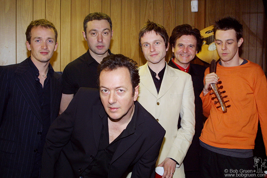 April 5 - Brooklyn - The Mescaleros pose before the show. From the left they are drummer Luke, bassman Simon (who also played the trombone), leader Joe Strummer, Martin who plays the guitar, flute, sax, harmonium and several keyboards; fiddle and banjo player Tyman Dogg and guitar player extraordinaire, Scott Shields.