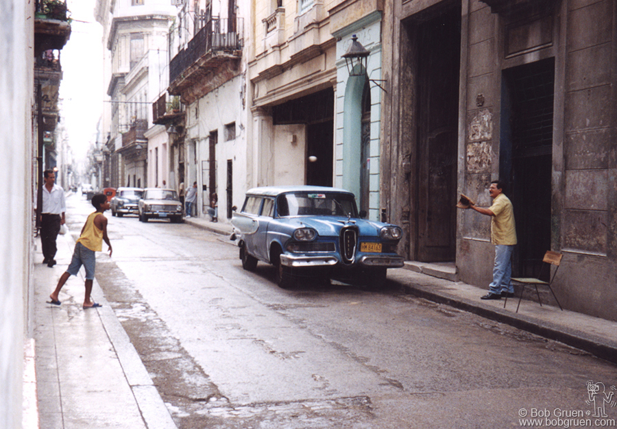 Baseball is very popular in Cuba, and you see people tossing a ball around everywhere. Check out the Edsel stationwagon in this shot. This car was rare in the US even when it first came out.