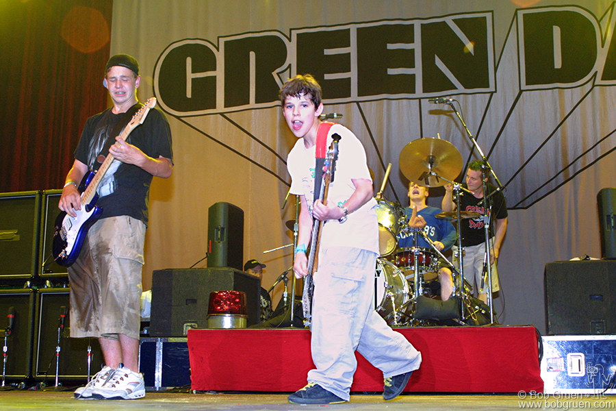 """When the band asked for fans to play for them, a very young guy in the front was waving a sign saying """"I can play bass"""" and Mike picked him. He took his moment and soared as the crowd roared. The boy who played lead was so good, Billie Joe let him keep the guitar."""