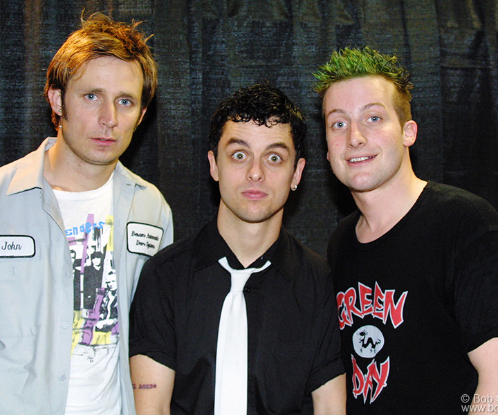 Green Day posed for a portrait backstage after the show. They are Mike, Billie Joe and Tre.