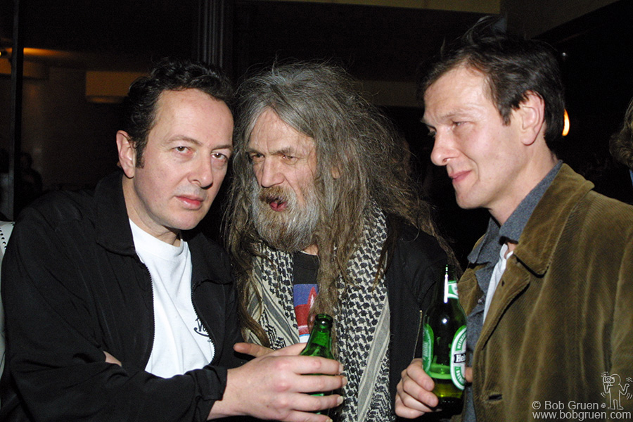 Joe has such interesting friends. Here he gets some advice from Joly as Hugo Guinness listens in.