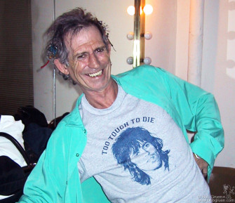 """March 6 - Keith Richards wearing a T-shirt with his photo and the words """"To tough to Die"""", and he looks proud of it!"""