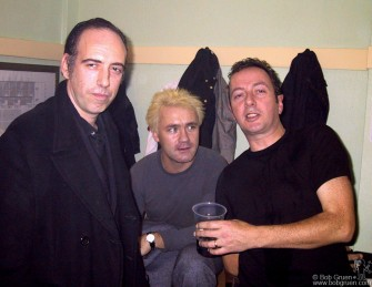 Nov 15 - Mick Jones and Damien Hirst visit with Joe Strummer backstage at London's Wembley Arena.