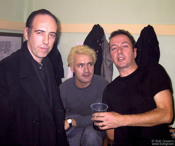 Nov 15 - London - Mick Jones and Damien Hirst visit with Joe Strummer backstage at London's Wembley Arena.