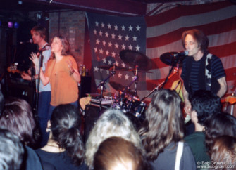 June 6 - Patti Smith Group plays at the Village Underground with an American flag background.