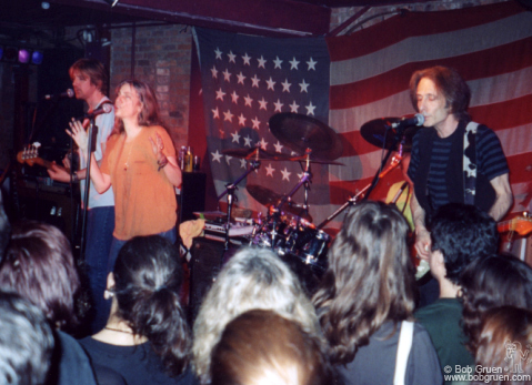 June 6 - NYC - Patti Smith Group plays at the Village Underground with an American flag background.