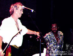 Keith gives a hand to the music director of the show, drummer Steve Jordan.