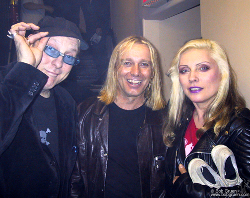"May 19 - NYC - Rick Nielsen and Robin Zander of Cheap Trick say ""Hi"" to eternally beautiful Debbie Harry of Blondie backstage at Joey's Birthday party."