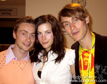 Backstage, Royston gets a hug from girlfriend, actress Liv Tyler as his brother Anthony gets in the picture