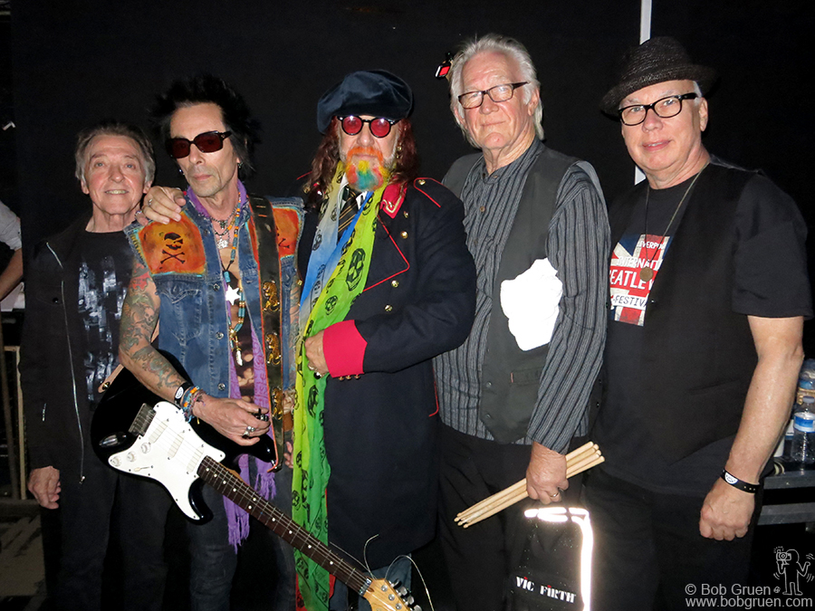 "Aug 31 – Liverpool, England – The featured headlining band of the International Beatle Week festival was ""The Boys Who Knew The Lads"" who all had a connection with the Beatles. Backstage at the Royal Court Theatre are Joey Molland (Badfinger), Earl Slick (John Lennon), Mark Hudson (Ringo), Denny Seiwell (Wings) and Gary Van Scyoc (Elephant's Memory Band)."