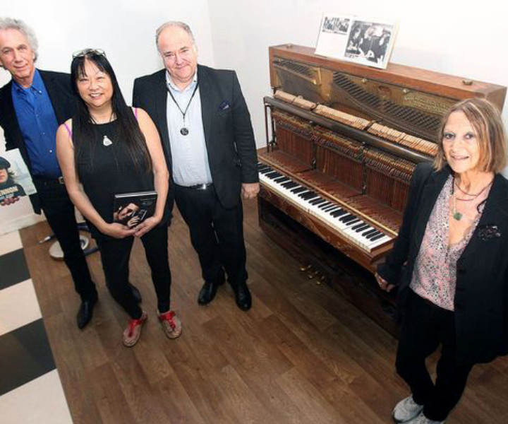 Aug 27 – Liverpool, England –  I was in Liverpool for the opening of a permanent exhibition of my photos at the Beatles Story Museum. Also unveiled was a piano used by John Lennon that had just arrived from New York. Here at the press conference I'm with May Pang, Museum director Martin King, and John Lennon's half sister Julia Baird.