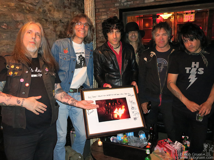 May 24 – NYC – D Generation presented writer David Fricke with my signed photo of them at their album release party at Berlin where  Fricke interviewed the band on stage.