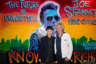 June 9 - NYC - BP Fallon and Bob Gruen posing in front of the Joe Strummer mural at Niagara Bar after BP's DJ set at the Electric Room.