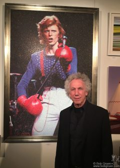 March 21 - NYC - Bob Gruen in front of his David Bowie piece being displayed at DIFFA's Dining By Design event at Pier 92.