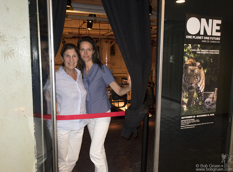 "Sept 15 – NYC – Giuli Cordara of the Time Shrine Foundation and artist Anne de Carbuccia in front of the ""One Planet One Future"" exhibit at the Westbeth Building."
