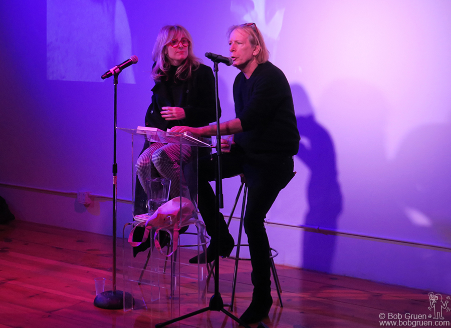 """Dec 20 – NYC – Writers Gillian McCain and Legs McNeil reading their book """"Please Kill Me"""" during the holiday party at Howl Gallery."""