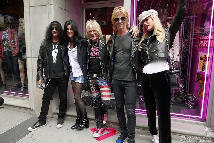 "Oct 13 – NYC – Slash of Guns N' Roses, Perla Ferrar, Jimmy Webb, Duff McKagen of Guns N' Roses and Susan Holmes celebrate the opening of Jimmy's new store ""I Need More"" on Orchard Street. Best Rock & Roll clothes in town!"