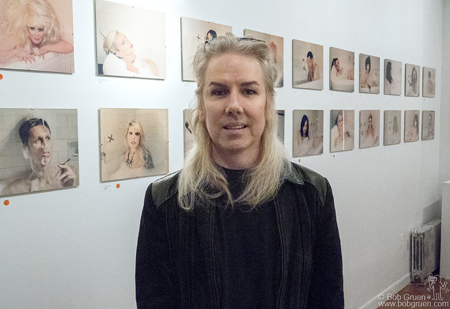 Nov 2 – NYC – Miss Guy in front of her amazing photographs during her exhibit at Art On A gallery.