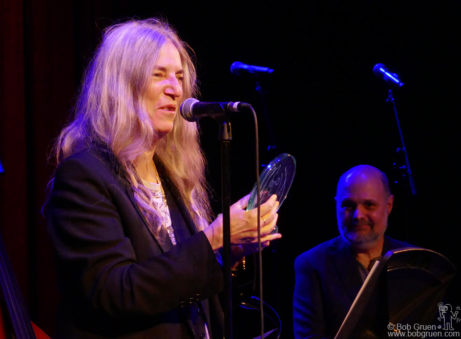 "Dec 1 – NYC – Patti Smith and Joe Raiola on stage when Patti received the 'John Lennon Real Love' award during the ""37th Annual John Lennon Tribute"" at Symphony Space."