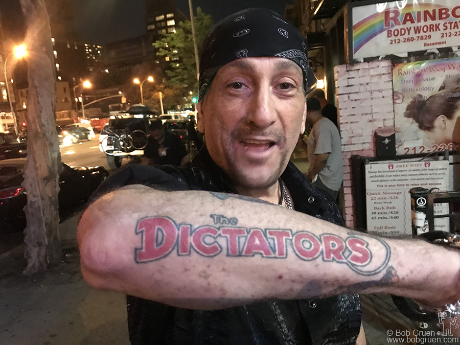May 9 – NYC – Handsome Dick Manitoba showing off his tattoo on the street in front of Bowery Electric.
